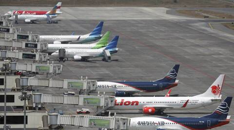 Budget airlines' passenger jets, Malaysia's AirAsia, top, Indonesia's Badavia Air, third from bottom, and Indonesia's Lion Air, second bottom, are parked on the tarmac with Indonesian planes of domestic airline Merpati Nusantara. (AP)