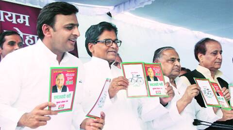 Akhilesh Yadav, Mulayam Singh Yadav and other party members release the manifesto in Lucknow Wednesday. Pramod Singh