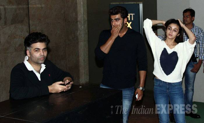 Alia, who had left her hair open, seems to be feeling the heat. While her 'Student Of The Year' producer and mentor Karan Johar just fiddled with his phone and Arjun just stood there. (Photo: Varinder Chawla)