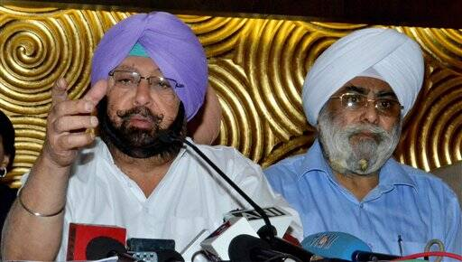 Congress candidate Capt. Amarinder Singh and Prime Minister Manmohan Singh's brother Surjit Singh Singh Kohli addresses a press conference in Amritsar on Saturday. (PTI)