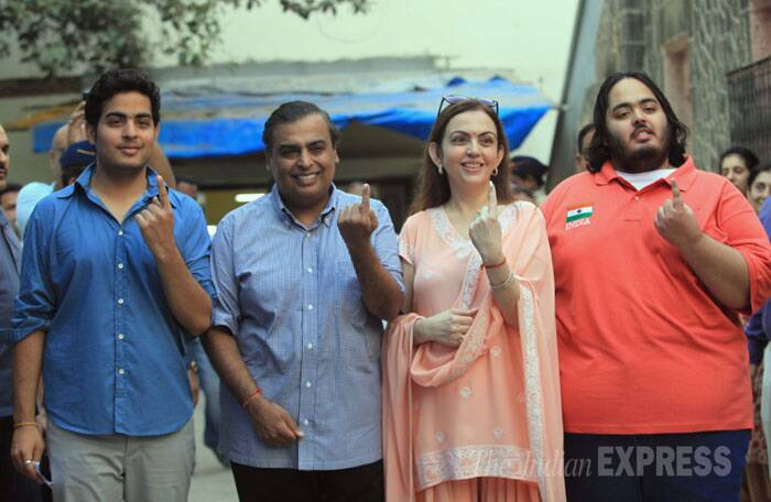 Chairman Reliance Industries Limited, Mukesh Ambani came to cast his vote along with wife Nita and sons Akash and Anant in Mumbai on Thursday. (IE Photo: Ganesh  Shirsekar)