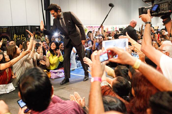 Anil Kapoor interacts with fans at the opening of the IIFA Expo at the Tampa Convention Center. (AP)