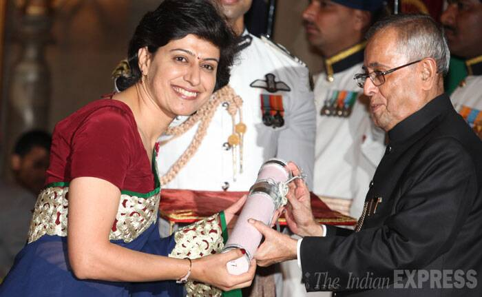 Cricketer Anjum Chopra receives her Padma Shri Award from President Pranab Mukherjee at the Rashtrapati Bhawan on Saturday. (IE Photo: Renuka Puri)