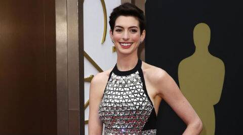 Anne Hathaway: I got a perfect purse-sized flask, which I put tequila in, and I had a great time! (Reuters)