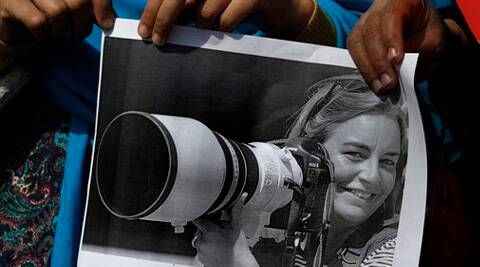 Journalists hold a picture of Associated Press photographer Anja Niedringhaus, 48, who was killed April 4, 2014 in Afghanistan. (AP)