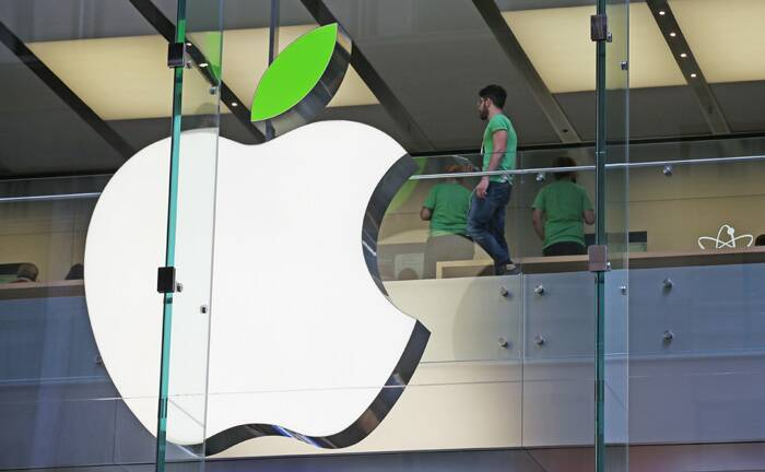 Employees wear green shirts near Apple's familiar logo displayed with a green leaf at the Apple Store timed to coincide with annual celebration of Earth Day in Sydney. (AP)