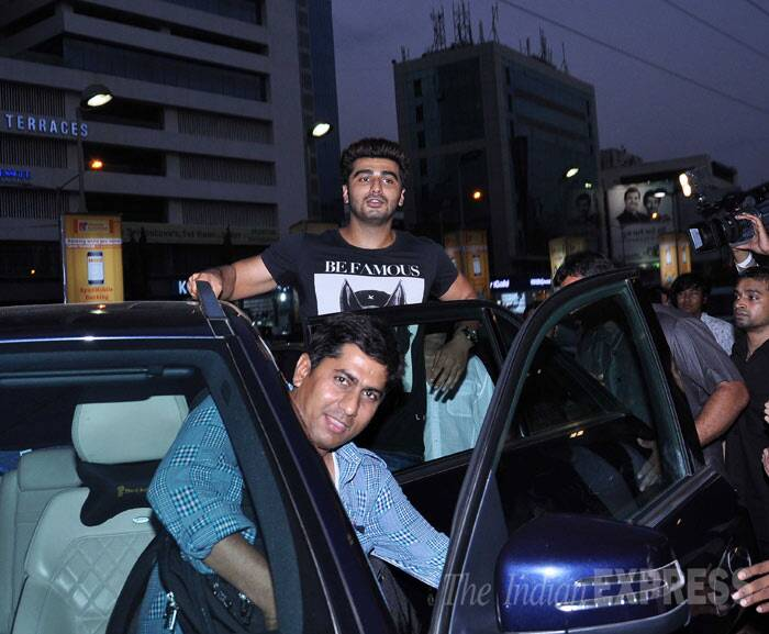 Her co-star Arjun Kapoor climbs onto the door of his car to greet hundreds of fans. (Photo: Varinder Chawla)