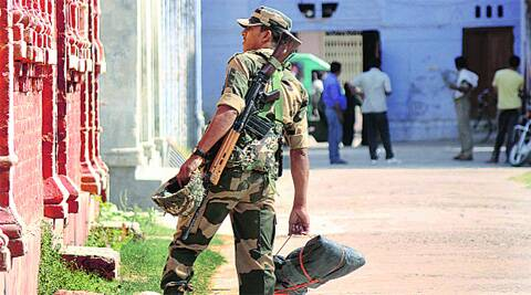 Security personnel at a polling booth in Lucknow, Tuesday. Vishal Srivastav