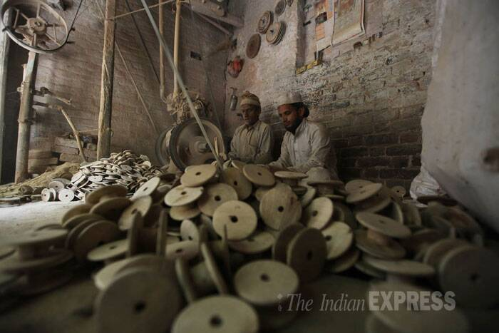 Craftsmen are busy making traditional wooden items to export them at a local factory in Sambhal in Uttar Pradesh. With government policies not in place for the protection of small scale artists and craftsmen, most of the industry in Sambhal is closed. (IE Photo: Tashi Tobgyal)
