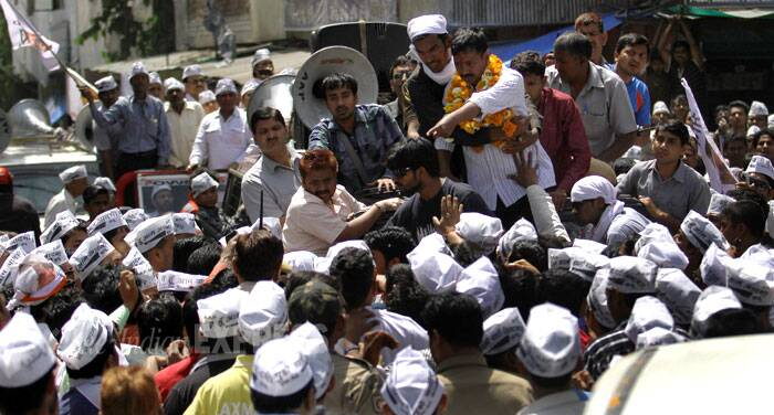 Later the man was thrashed by AAP workers and handed over to police. (IE Photo: Ravi Kanojia)