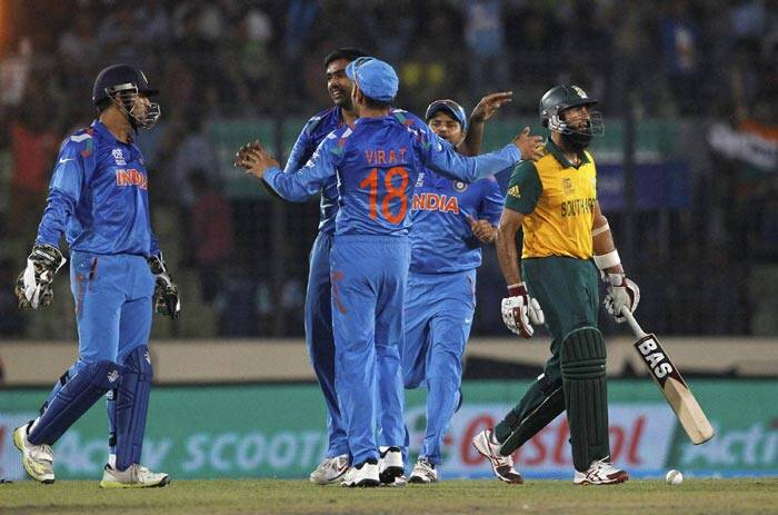 India stormed into the final of the ICC World T20 with a resounding six-wicket victory over South Africa (AP)