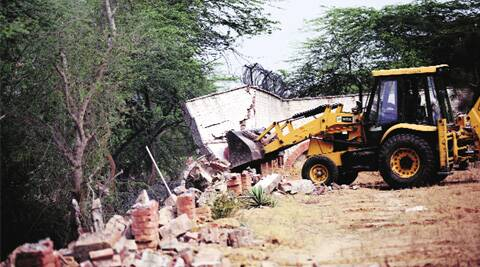 A farmhouse being razed in Asola Bhatti Wildlife Sanctuary. (Praveen Khanna)