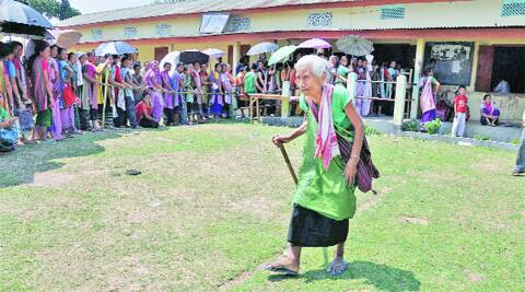People queue up to cast their votes in Diphu, Karbi Anglong, on Saturday. PTI