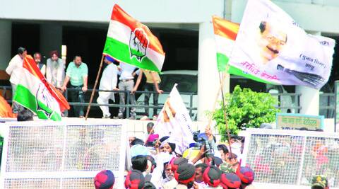 Congress and AAP workers outside Mini Secretariat on Monday. (Gurmeet Singh)