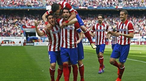 Atletico's Raul Garcia, center right, celebrates his goal with teammates during a Spanish La Liga soccer match between Atletico Madrid and  Villarreal (AP)