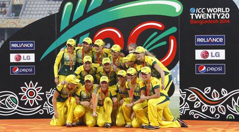 Australian players pose for a group photo while celebrating with the winner's trophy after their win over England in the ICC Women's Twenty20 Cricket World Cup final match in Dhaka, Bangladesh on Sunday. (AP)