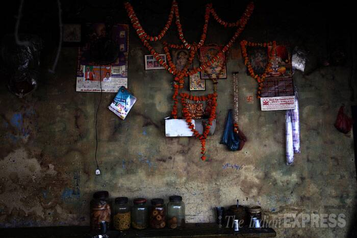 A tea stall with posters of Hindu Gods at the temple town of Ayodhya in Uttar Pradesh. (IE Photo: Tashi Tobgyal)