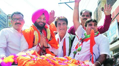 Congress candidate Ravneet Singh Bittu with Raj Babbar during the road show in Ludhiana on Thursday. (Gurmeet Singh)