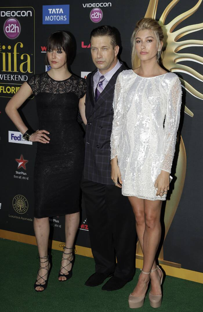 Alaia Baldwin, Stephen Baldwin, and Hailey Rhode Baldwin pose for photographers as they walk the green carpet. (AP)