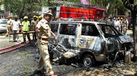 Bangalore police named 14 people in the Malleswaram BJP office blast that injured 18 people and damaged 23 vehicles. (PTI file photo)