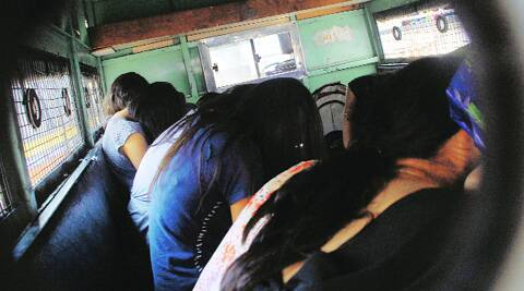The arrested women being taken to the Sassoon hospital for medical examination on Sunday. (Sandeep Daundkar)