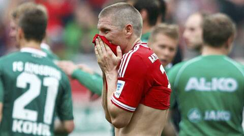 Bayern Munich's Bastian Schweinsteiger reacts after his team lost to Augsburg on Saturday. (Reuters)
