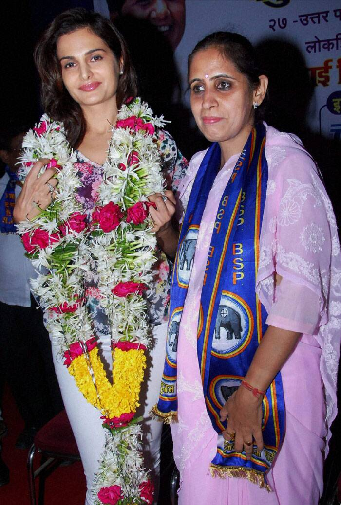 Bollywood actor Monica Bedi with  BSP candidate Pushpa Milind Bhole during a campaign in Mumbai. (PTI)