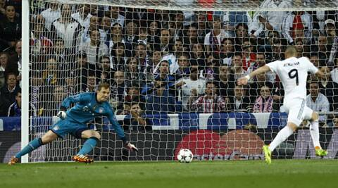 'Keeper Manuel Neur can do litte apart from watching Karim Benzema tap in Real Madrid's only goal of the night against Bayern Munich at the Bernabeu. (AP)