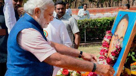 BJP's prime ministerial candidate Narendra Modi offers flower tributes to Babasaheb Ambedkar at Gujarat assembly house in Gandhinagar recently.  (File Photo: PTI)