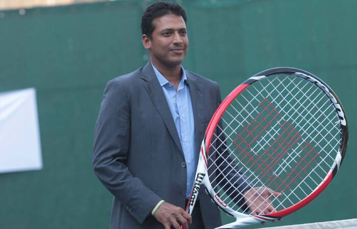 Mahesh Bhupathi holds the newly launch spin effect technology Tennis racquets after the media briefing held at CCI court, Churchgate on Wednesday. (Express photo: Kevin DSouza)