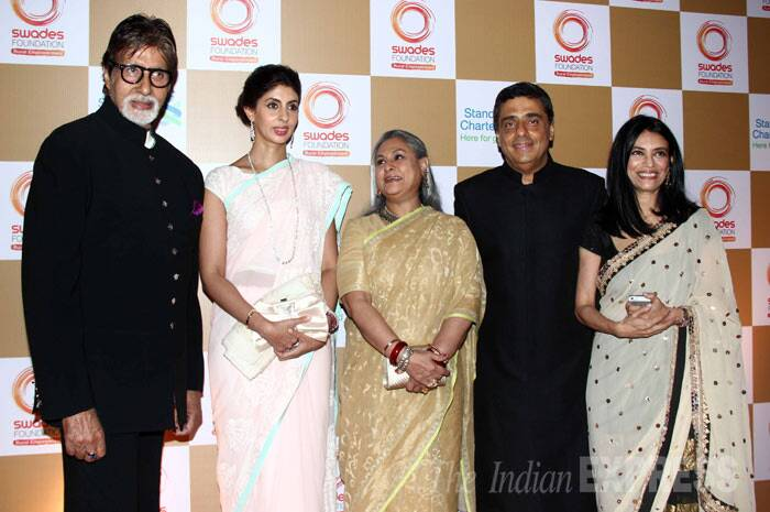 The Bachchan family poses for a picture along with Ronnie Screwvala and his wife Zarina. (Photo: Varinder Chawla)