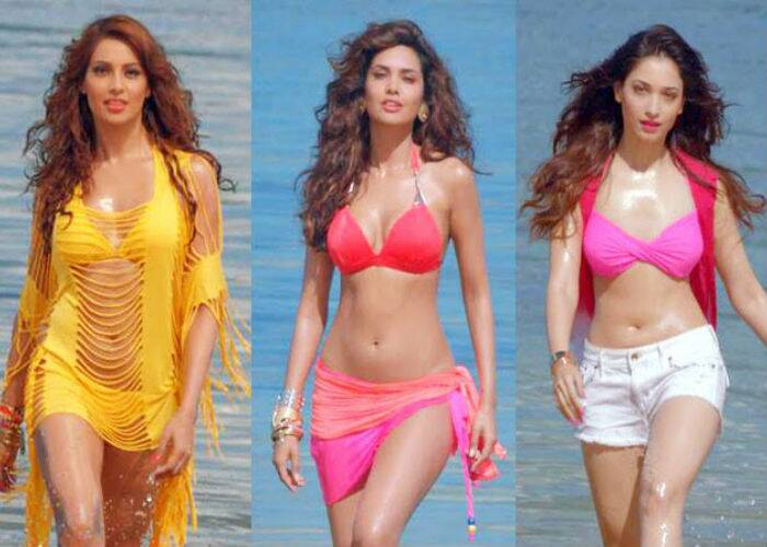 Bollywood hotties Bipasha Basu, Esha Gupta and Tammanah Bhatia set the summer temperature soaring even higher with their sexy bikini avatars in upcoming film, 'Humshakals'. <br /><br /> All the three girls are seen flauting their rocking bodies – Bipasha in a yellow bikini with a stringy coverup, Esha Gupta in a red halter bikini top and a sarong, while Telugu actress Tamannah sports a pink bikini top with white denim cutoffs.