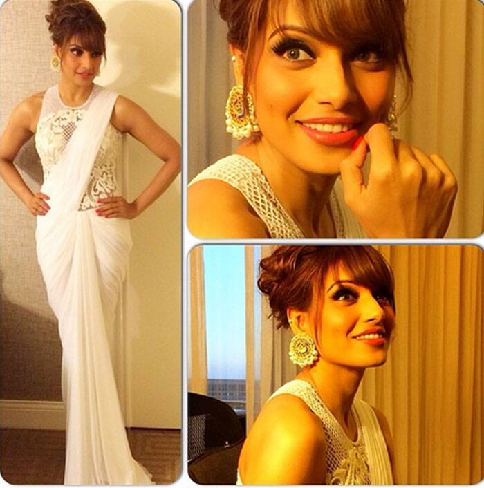 Bipasha Basu was a beautiful sight in a white Sonaakshi Raaj draped sari-gown with Amrapali earrings.  (Twitter)