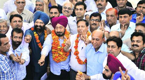 From left: Garlanded J S Gogia (general secretary), Baljinder Singh Bittu (chairman) and J C  Verma (vice-chairman) at the community centre in Sector 27, Chandigarh, on Sunday. (Photo: Kshitij Mohan)