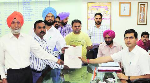 Bittu (second from left) files his nomination papers in Ludhiana on Wednesday. Gurmeet Singh