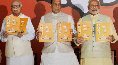 BJP Prime Ministerial candidate Narendra Modi, Party President Rajnath Singh C and senior leader Lal Krishna Advani release the party's election manifesto in New Delhi. (PTI)