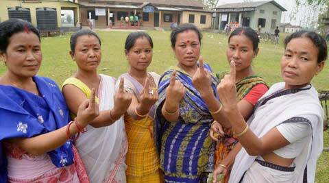 Bodo tribal women show their mark after casting their vote at Beloguri in Nagaon on Monday. PTI Photo