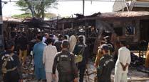 Bomb blast hits train in southwest Pakistan, killing13