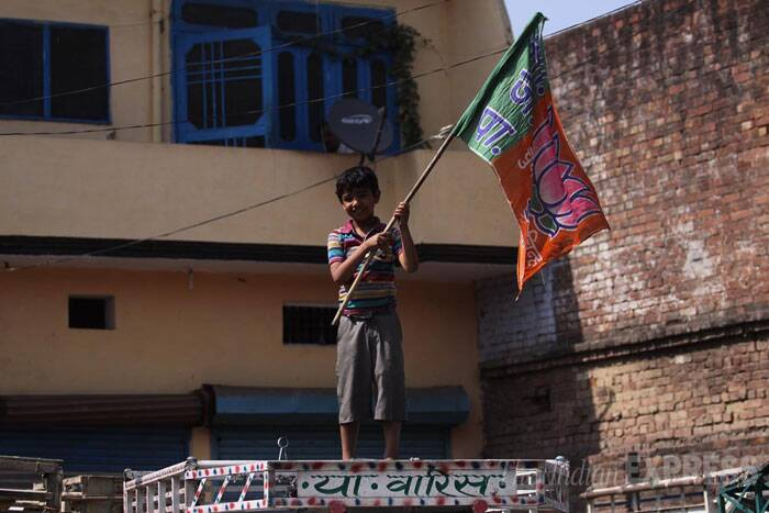 A young boy waves the BJP flag during the party roadshow in Bareilly in Uttar Pradesh. Bareilly is a region which had witnessed riots two years ago. (IE Photo: Tashi Tobgyal)