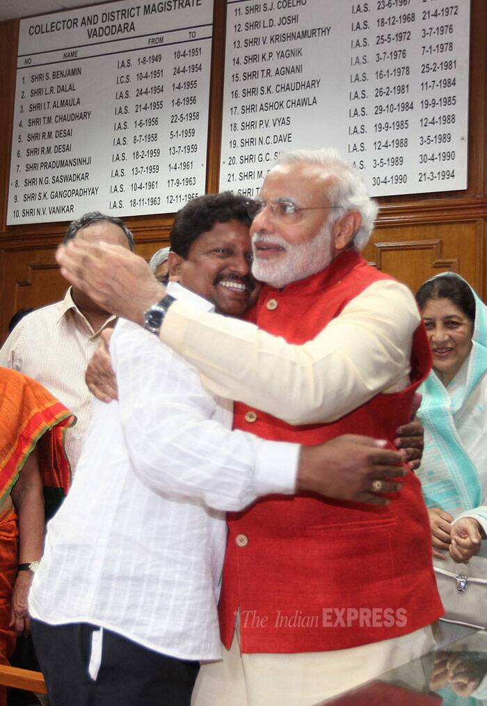 63-year-old Modi filed his nomination after a roadshow that was attended by thousands of BJP workers and supporters, who thronged the city streets. BJP Prime Ministerial candidate Narendra Modi greets tea vendor Kiran Maheda, one of the signatories of his nomination from Vadodara. (IE Photo: Bhupendra Rana)