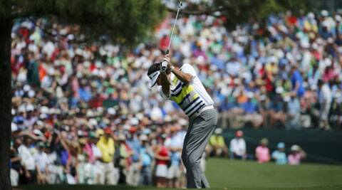 Bubba Watson hits a shot on the 17th hole during the second round of the Masters golf tournament. (Reuters)