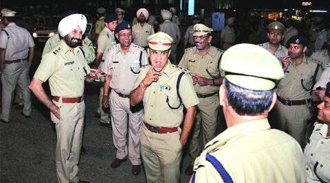 UT SSP Sukhchain Singh Gill with other police officers at ISBT-17in Chandigarh on Sunday.
