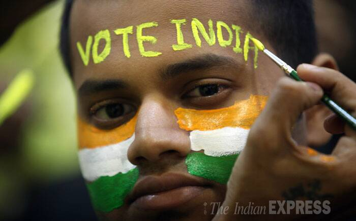 A boy gets 'Vote India' written on his forehead ahead of polling in Mumbai on Wednesday.  (IE Photo: Prashant Nadkar)