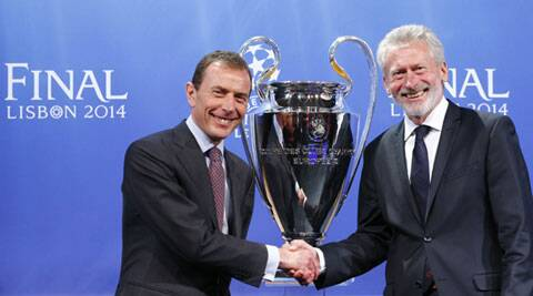 Bayern Munich's ambassador Paul Breitner (R) shakes hands with Real Madrid's ambassador Emilio Butragueno after the draw for the Champions League semi-finals. (Reuters)