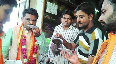 Chavda enjoys a cup of tea at Jethi's stall in Vaniyavad, Bhuj, on Monday. (Express)