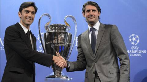 Atletico Madrid ambassador Jose Luis Perez Caminero, (R) shakes hands with Chelsea ambassador Paulo Ferreira after the Champions League semi-finals draw on Friday. (AP)