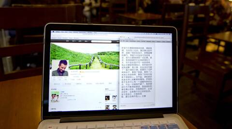 A page from Chinese actor Wen Zhang's Sina Weibo account showing an apology statement to his wife and children posted by him is displayed on a computer screen at a cafe in Beijing. (AP)