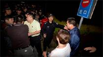 China shuts embassies after protests by MH370 relatives