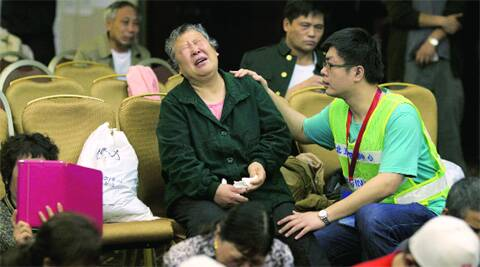 A relative of one of the Chinese passengers onboard MH370 grieves at a hotel conference room in Beijing Friday evening. (Photo: AP)