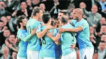 Manchester City stay in hunt after first-half blitz
